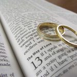 Wedding rings on open Bible