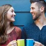 Happy couple talking with coffee