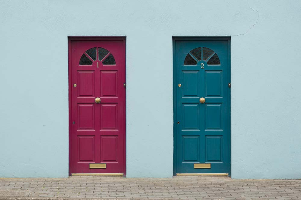 Two colourful domestic front doors