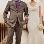 Bride and Groom, arm in arm in church aisle